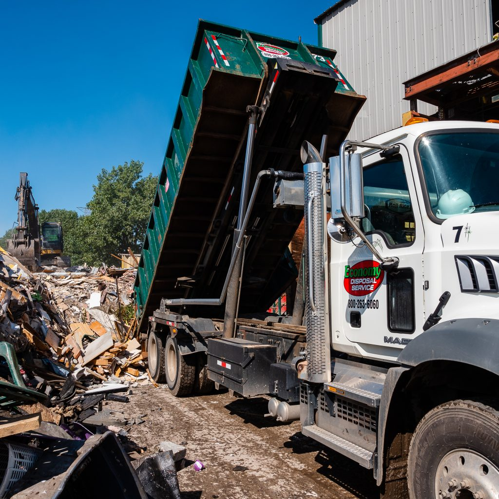 Economy Disposal truck at a recycling facility